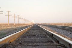 To infinity. Looking down the railroad track to infinity royalty free stock photos