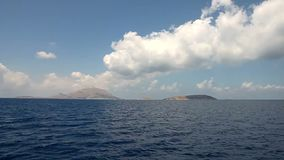 To the island. Navigating to a small island in the mediterranean sea stock footage