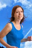 To jog for fitness. Young, beautiful woman is jogging Royalty Free Stock Photography