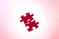 To join puzzle (pink). To join puzzles like a love or help symbol Royalty Free Stock Image