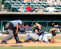 Too Late!. Charleston RiverDogs catcher Rainiero Coa dives at baserunner Michael Danner of the Kannapolis Intimidators, but is too late in reaching him before he Royalty Free Stock Photo