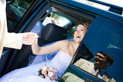 To leave a car. Groom helps to bride to leave a car stock images