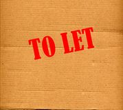 To let. Cardboard with red ink to let advertisement Royalty Free Stock Image