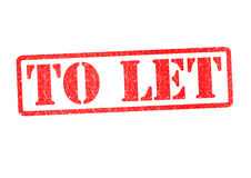 TO LET. Rubber Stamp over a white background Stock Photos
