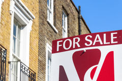 To Let sign outside a London townhouse. London, UK - April 8, 2017 - For Sale sign outside a English townhouse Stock Photo