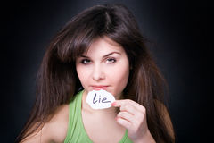 To lie or not to lie?. Sexy young woman. Lie or truth Stock Image