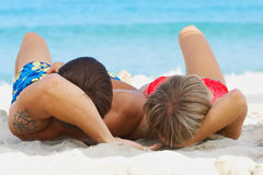 To lie on the sand Royalty Free Stock Photo
