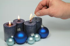 To light blue candles royalty free stock image