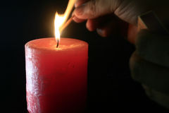 To light a candle Stock Images