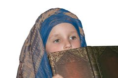 To listen attentively . To think and analyze acts. Spiritual education. Studying of a Scripture. The prayer book for the child. The girl in a scarf before a stock photos