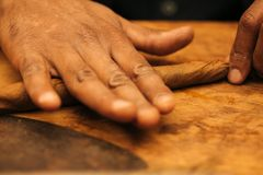 To make a cigar with his hands, sheets for a cigar, handwork.  royalty free stock image