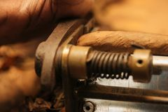 To make a cigar with his hands, sheets for a cigar, handwork.  Royalty Free Stock Photos