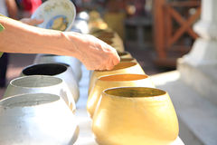 To make merits in monk's alms bowl Stock Image