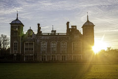 To The Manor Dawn. Typical English countryside manor house pictured at dawn with the sun above the horizon. Symbolic of wealth, luxury and title Stock Photos