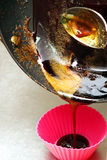 To melt the sugar in a pan. Interfere with melted sugar spoon.  Royalty Free Stock Images