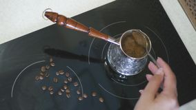 To mix coffee in a turkey on an electric stove. 4k, 3840x2160. HD stock footage