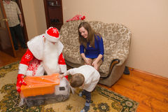 To  mother and her son came to Santa Claus and brought a gift Stock Photo