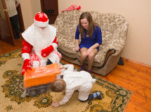 To  mother and her son came to Santa Claus and brought a gift Royalty Free Stock Photos