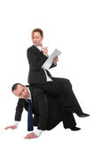 To move up the ladder. Woman sits confidently on a man Stock Photos