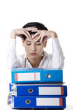 To much work to do. Sad woman with ringbinders Stock Photography