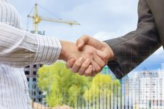 To negotiate business on the background of the construction. Royalty Free Stock Images