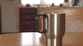 To open and close a Mug thermos with Steam stock footage
