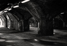 To the outside. Going through an old railway viaduct to the outside taken in black and white Royalty Free Stock Image