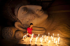 To pay her respect to the Buddha statue. Stock Photography