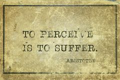 To suffer Aristotle. To perceive is to suffer - ancient Greek philosopher Aristotle quote printed on grunge vintage cardboard Stock Photo