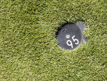 95 to the pin. 95 yards distance mark Royalty Free Stock Images