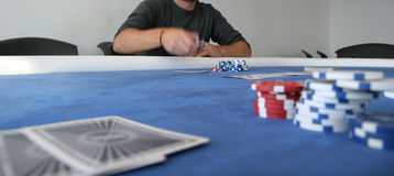 About to place a bet. A poker player is about to place a bet with only two players in the game left Stock Photo