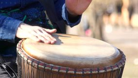 To play rhythm on Tom-Tom. Men`s hands play a drum on volume stock video