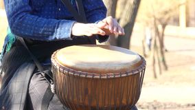 To play rhythm on Tom-Tom. Men`s hands play a drum on volume stock footage