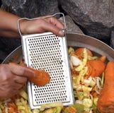 To prepare sharp salad. Female handscrush vegetables for preparation of sharp salad Stock Photo