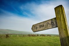 To the pub sign in rural setting stock photo