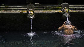 To Purify. In the temple of bali,One cleanses itself from sins and temptation. And hope for a better self Stock Image