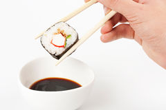 About to put delicious makizushi Stock Images