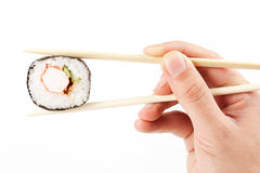 About to put delicious makizushi Stock Image