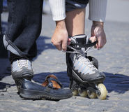 To put on roller skates Royalty Free Stock Image