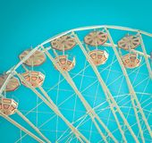 Ferris wheel on blue sky background in color close-up stock photo