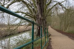 Detailed view of nearby hand-rails seen adjacent to an inland river in the UK royalty free stock photography