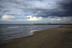To Scarborough. From Sandsend beach on a stormy day Stock Image