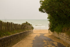 To the sea. The road to the ocean, in a cloudy day Royalty Free Stock Image