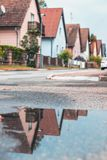 A picture of family houses taken with a reflection in water. stock images
