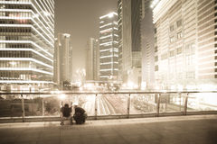 To see the night view of bustling city. The expression of abstract urban landscape,mother and baby see the world stock image