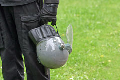To serve and protect. A policeman holding his helmet. space for copy Stock Photo