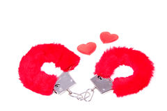 To sexy red handcuffs Stock Photos