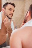 To shave or not to shave. Royalty Free Stock Image