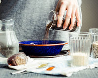 To shift from a glass in a plate of flax seeds for cooking crack Stock Photos