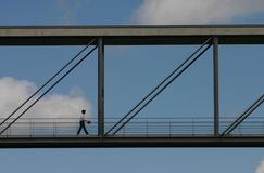 To the sky. Man walking on a bridge Stock Photography